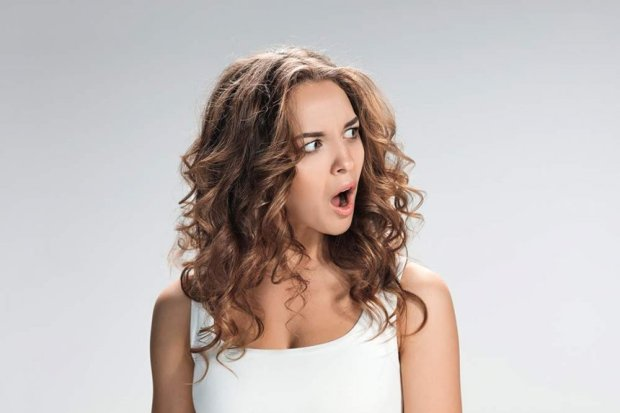 portrait-of-young-woman-with-shocked-facial-P79GDP5.jpg